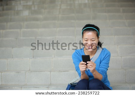 college student use smart phone sit on stairs