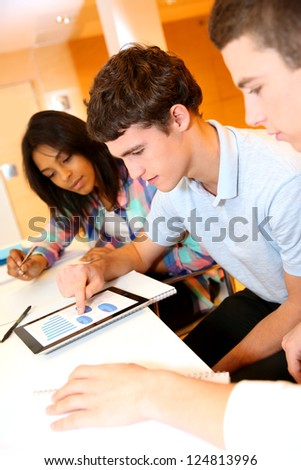 College students in training class with tablet - stock photo