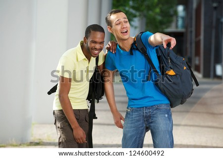 College students laughing on campus - stock photo