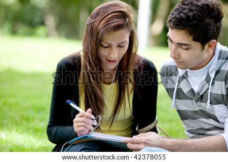 college students smiling outdoors looking happy - stock photo