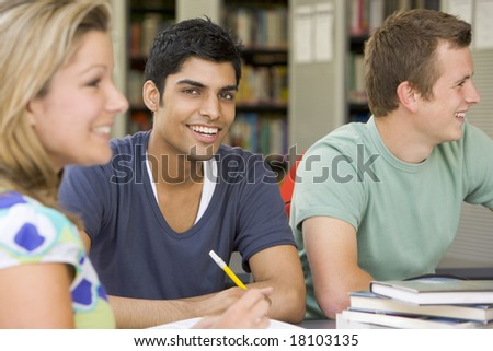college students studying in library - stock photo