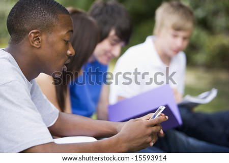 College students studying outside - stock photo