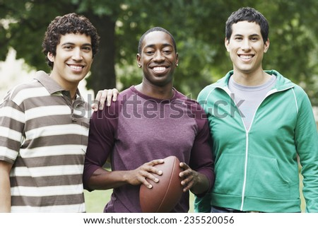 College Students with Football - stock photo