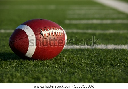 Collegiate Football on the Field with room for copy - stock photo