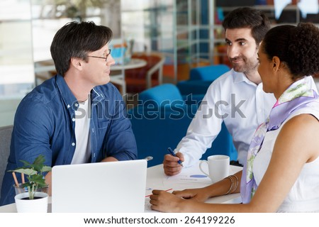 Collegues working together in an office - stock photo