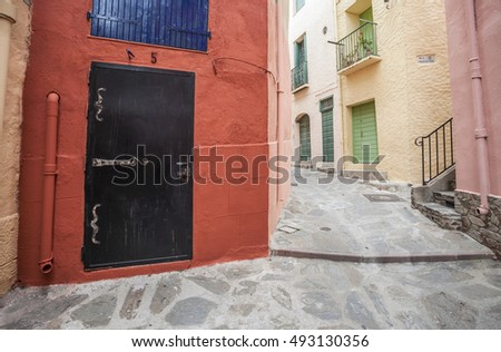 COLLIOURE,FRANCE-JUNE 17,2011: Colored walls houses in street of old town of Coullioure,Cote Vermeille, France.