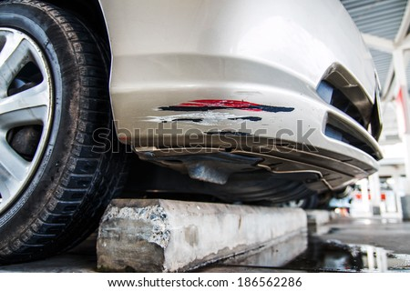 collision car caused by crash with the pavement. - stock photo