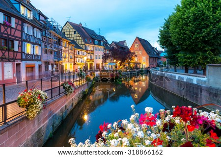 Colmar, Petit Venice, at dusk water canal and traditional colorful houses. Alsace, France. - stock photo