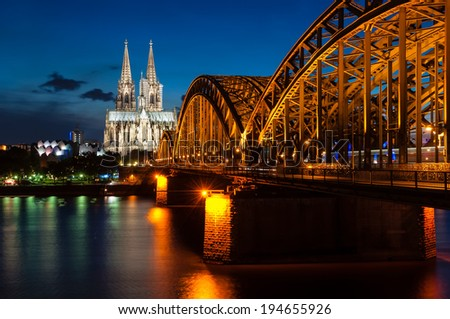 Cologne at night with Hohenzollern bridge and cathedral - stock photo