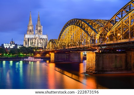 Cologne Cathedral and Hohenzollern Bridge at night, Germany - stock photo