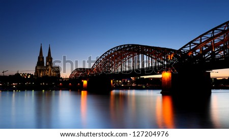 Cologne Cathedral is a Roman Catholic church in Cologne, Germany, at night as seen from the Rehin - stock photo