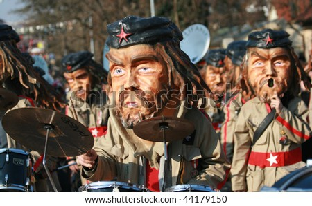 COLOGNE - CIRCA FEB 2008 : Participants in Che Guevara mask parade at the traditional carnival parade circa February 2008 in Cologne, Germany.