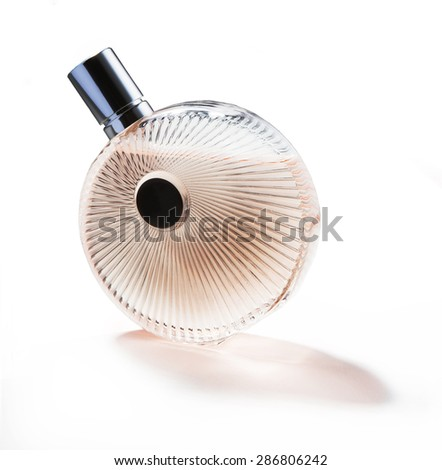 cologne for women isolated with reflection and shadow - stock photo