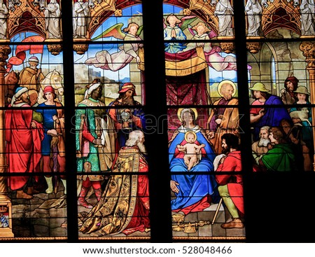 COLOGNE, GERMANY - APRIL 21, 2010: Stained Glass in the Dom of Cologne, Germany, depicting the Adoration of Christ by the Three Kings.