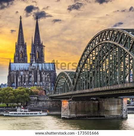 Cologne, Germany at the cathedral and bridge over the Rhine River. - stock photo