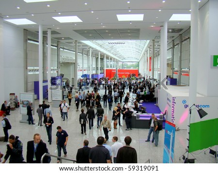 COLOGNE, GERMANY - AUGUST 18: People start crowding the Gamescom Business Area on August 18, 2010 in Cologne. Gamescom is a European trade fair for interactive games and entertainment.