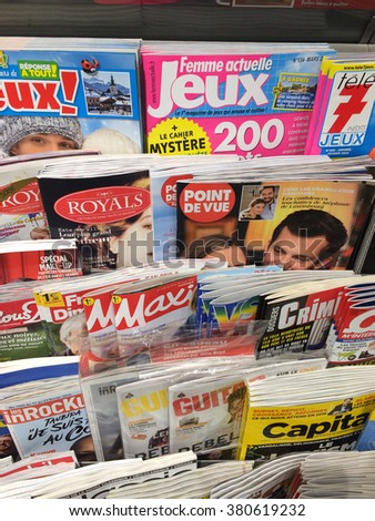 Cologne,Germany- February 23,2016: Popular French magazines on display in a store in Cologne,Germany.    - stock photo