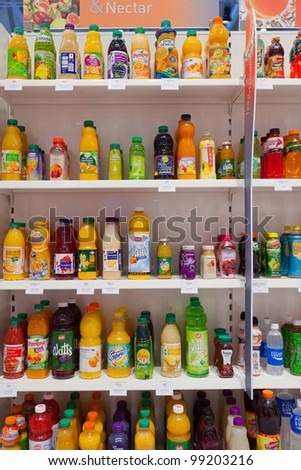 COLOGNE, GERMANY - MARCH 27 : Many different drink bottles on display at the Sidel booth at the ANUGA FoodTec industry trade show in Cologne, Germany on March 27, 2012. - stock photo