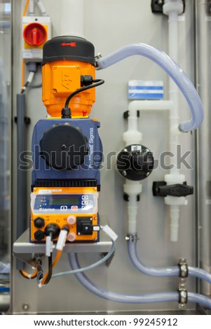 COLOGNE, GERMANY - MARCH 27 : New BlueCIP Clean In Place system with ECA on display at the Loehrke booth at the ANUGA FoodTec industry trade show in Cologne, Germany on March 27, 2012. - stock photo