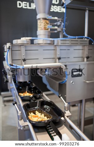 COLOGNE, GERMANY - MARCH 27 : New dosing machine SD for trend food on display at the Leonhardt booth at the ANUGA FoodTec industry trade show in Cologne, Germany on March 27, 2012. - stock photo