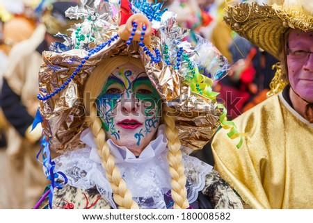COLOGNE, GERMANY - MARCH 03: unidentified and costumed people at the Rose Monday parade on March 03, 2014 in Cologne. The parade is the largest carnival parade in Germany.