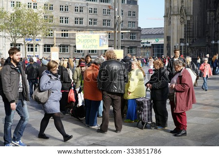 COLOGNE, GERMANY - OCTOBER 23, 2015: distribution of food to the homeless in the center of Cologne in Germany