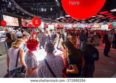 COLOGNE, GERMANY - SEPTEMBER 19, 2014: Canon stand in the Photokina Exhibition. The Photokina is the world's largest trade fair for the photographic and imaging industries - stock photo