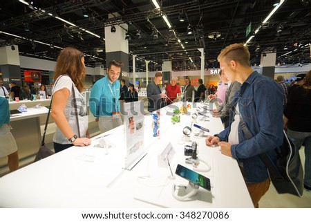 COLOGNE, GERMANY - SEPTEMBER 19, 2014: Samsung stand at the Photokina Exhibition. The Photokina is the world's largest trade fair for the photographic and imaging industries - stock photo
