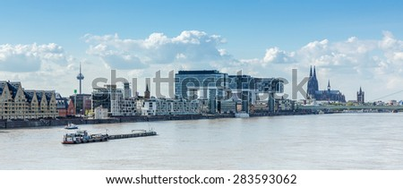 Cologne in germany with crane houses and Cathedral at the rhine river in germany - stock photo