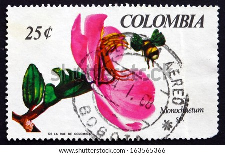 COLOMBIA - CIRCA 1967: a stamp printed in the Colombia shows Monochaetum Orchid and Bee, circa 1967 - stock photo