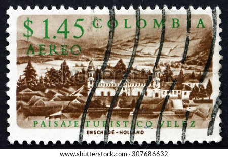 COLOMBIA - CIRCA 1961: a stamp printed in the Colombia shows View of Velez, Town of the Santander Department in Northeastern Colombia, circa 1961 - stock photo