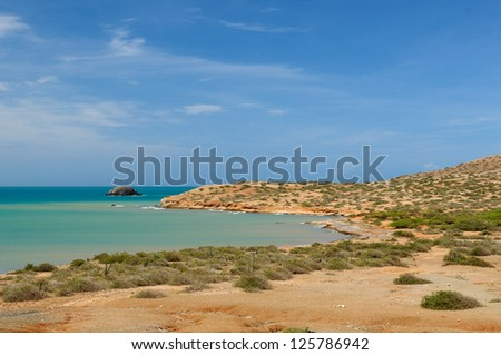 Colombia, wild coastal desert of Penisula la Guajira near  the Cabo de la Vela resort. The picture present beautiful beaches of the Caribbean coast with turquoise water and orange sand