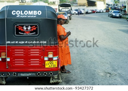 COLOMBO, SRI LANKA - FEB. 22: Worker of Sri Lankan traditional taxi  on Feb 22, 2011 in Colombo. Colombo is the largest city and former capital of Sri Lanka with population about 1 million people. - stock photo