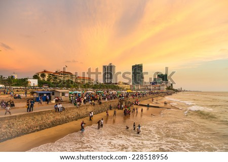 Colombo, Sri Lanka - February 16 2012: A large crowd enjoys the sunset on Galle fort road on the seafront of Colombo, the capital city of Sri Lanka - stock photo
