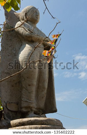 COLOMBO, SRI LANKA - MARCH 16: Famous standing Buddha statues in the Seema Malaka Temple in Colombo on March 16, 2013. This is situated on Beira Lake and is part of the Gangaramaya Buddhist Temple