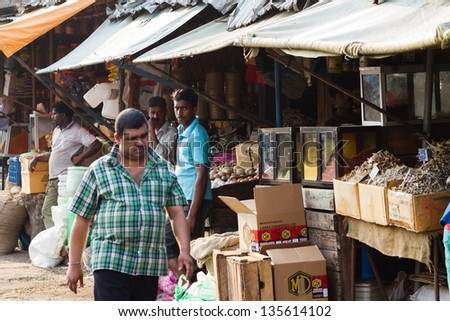 COLOMBO, SRI LANKA - MARCH13: Traditional street market on March 13, 2013 in Colombo, Sri Lanka. Street market is the component of traditional Sri Lankan culture. - stock photo