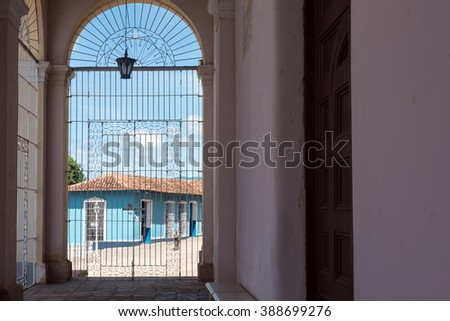 Colonial architecture in main plaza seen from the Holy Trinity Cathedral Porch. Trinidad is a Unesco World Heritage Site - stock photo
