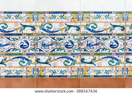 Colonial house architecture vintage floor tiles depicting ducks and turkeys as  decorative design - stock photo