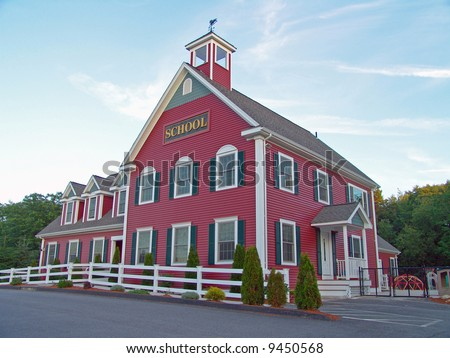 Colonial House School Building Against Blue Sky - stock photo