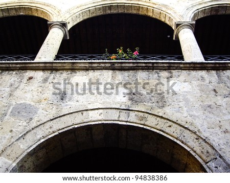 Colonial style arched wall in Guadalajara, Mexico - stock photo