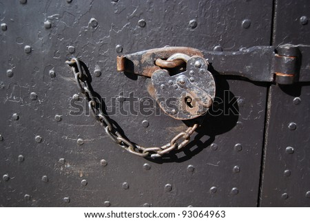 Colonial Williamsburg, VA - Old metal lock with chain - stock photo