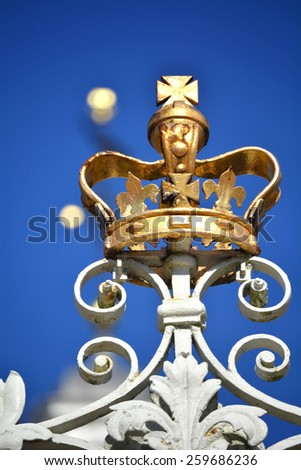 COLONIAL WILLIAMSBURG, VIRGINIA - NOVEMBER 19  2014: Close up of the golden crown atop The Governors Palace gate. The restored town is a major attraction for tourists and educational field trips.  - stock photo