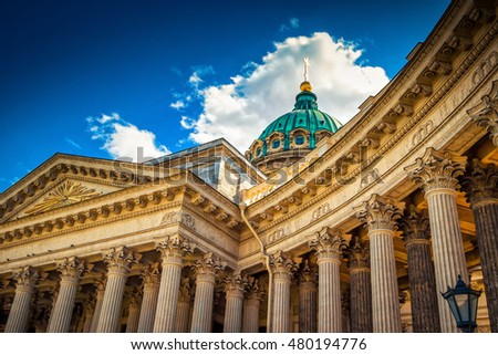 Colonnade and blue dome with golden cross on Kazansky cathedral in Saint Petersburg, Russia.