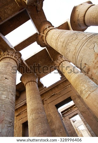 Colonnade engraved egyptian images and hieroglyphs in Sobek Temple, Kom Ombo, Egypt