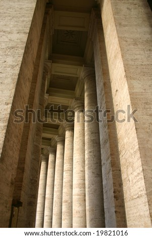 Colonnade in Saint Peter square in Vatican, Rome - stock photo
