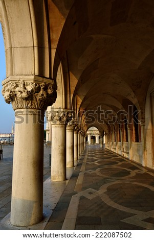 Colonnade Palazzo Ducale at sunrise in Venice, Italy. Formerly the residence of the Doge and now a museum, the palace is one of the main landmarks of the city  - stock photo