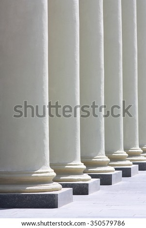 Colonnade. Several columns of sunlit perspective