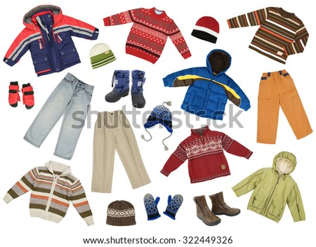 Color- and size-coordinated collection of boys winter clothes, isolated on white - stock photo