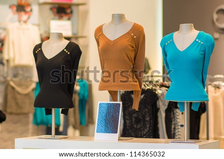 Color blouses on mannequins in mall