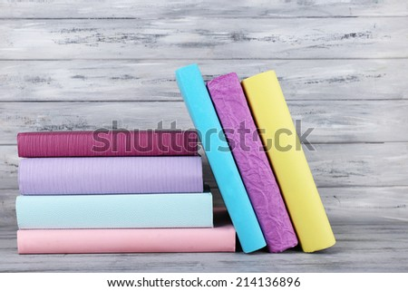 color books on grey wooden background - stock photo